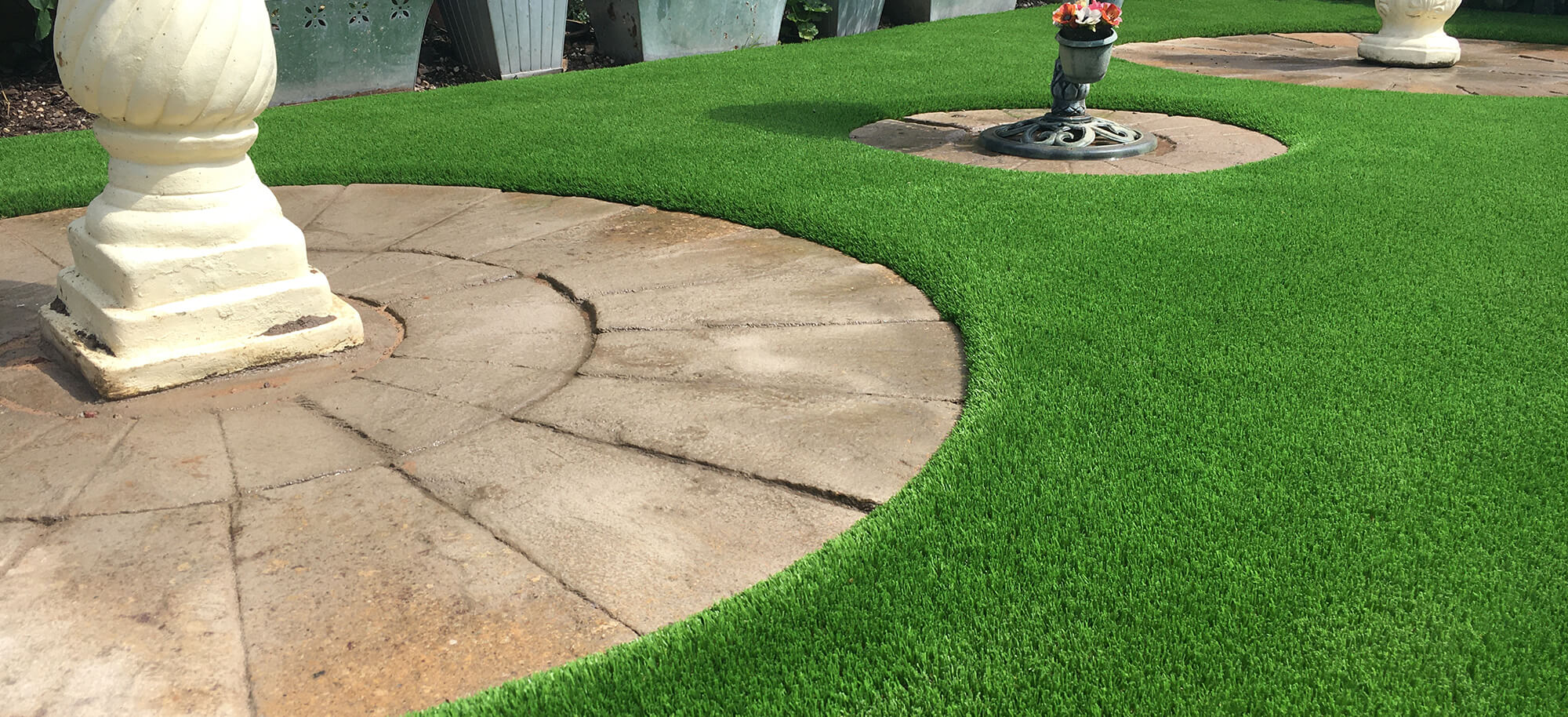 A completed LazyLawn installation using the VertEdge edging system
